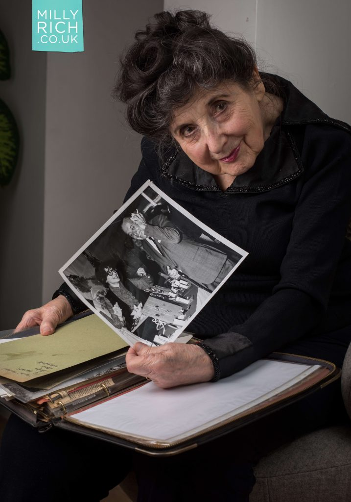 Milly Rich, 97, showing a photo of her and Cyril Fletcher in 1969