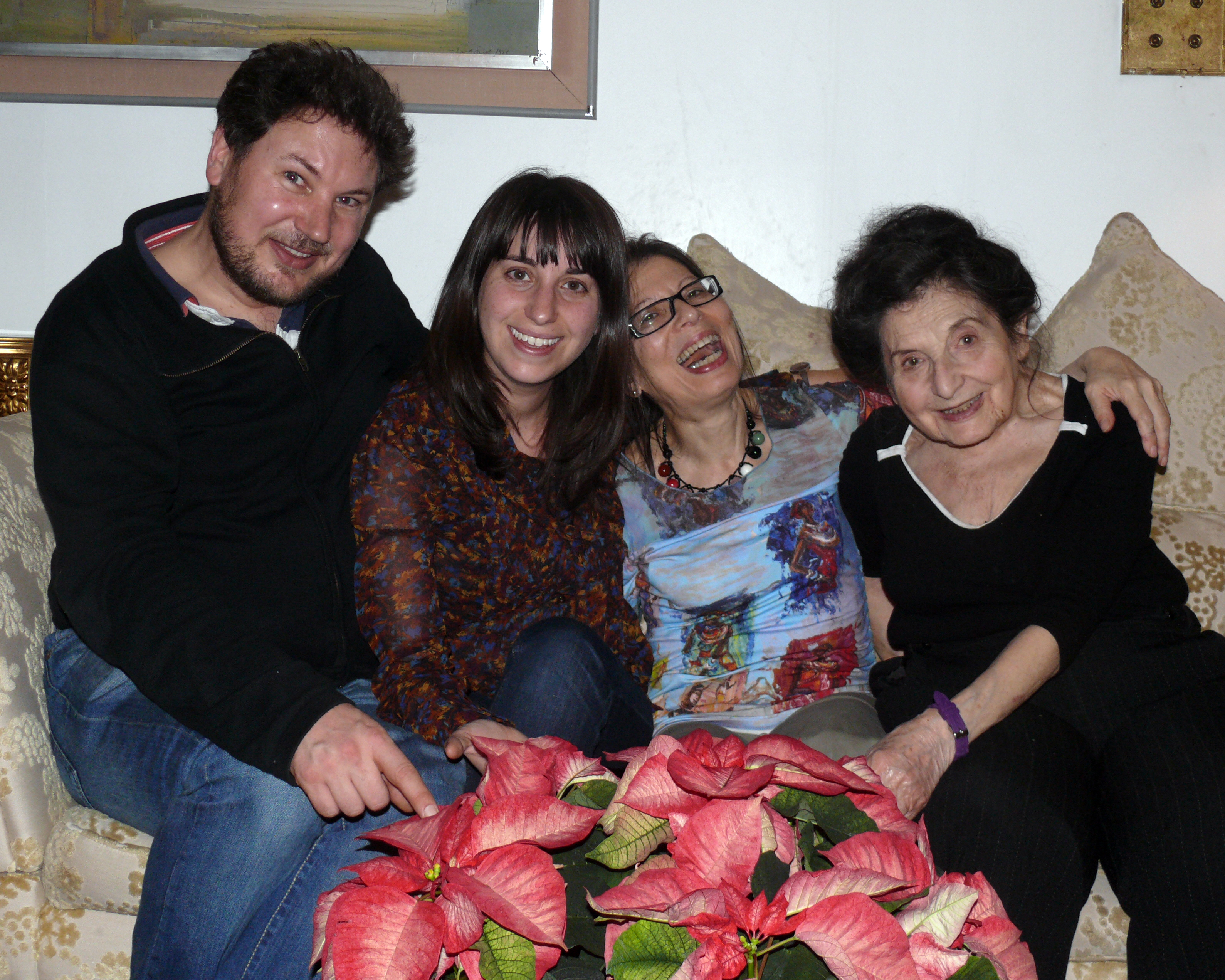 Milly & Shula Rich, Niece Caroline & Phil, sitting on the sofa all smiling